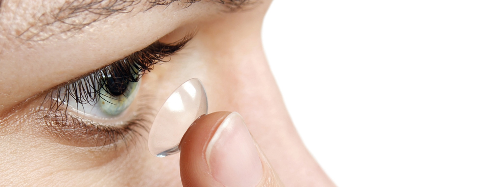 Someone putting a contact lens into their eye