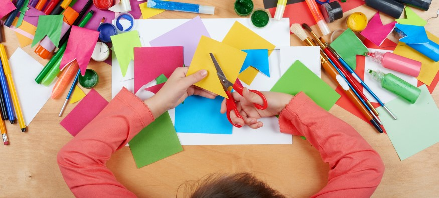 child with arts and crafts materials