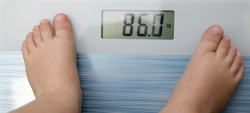 Child standing on weighing scales
